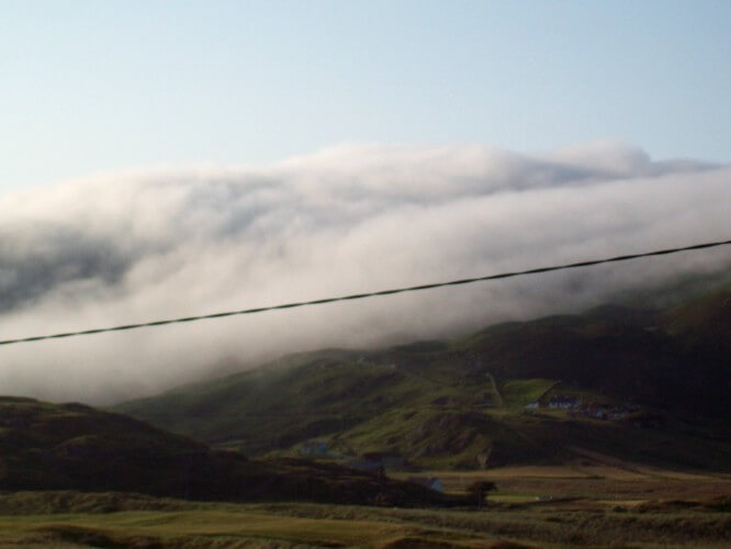 Unusually warm temperatures caused this eerie, creeping mist, which reminded me of the fog coming through the Golden Gate in San Francisco! Glencolmcille, Co. Donegal, 2013, by Audrey Nickel