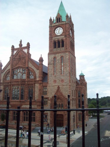 A look at Derry's Guildhall from the wall. Sign next to the main door has inscriptions in English, Irish, and Ulster Scots.