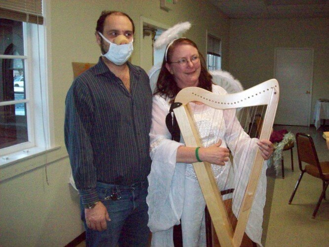 "OK, I'll admit that harp-playing angels aren't all that scary, but Tony's ""swine flu"" costume on the other hand... 2009, by Audrey Nickel"